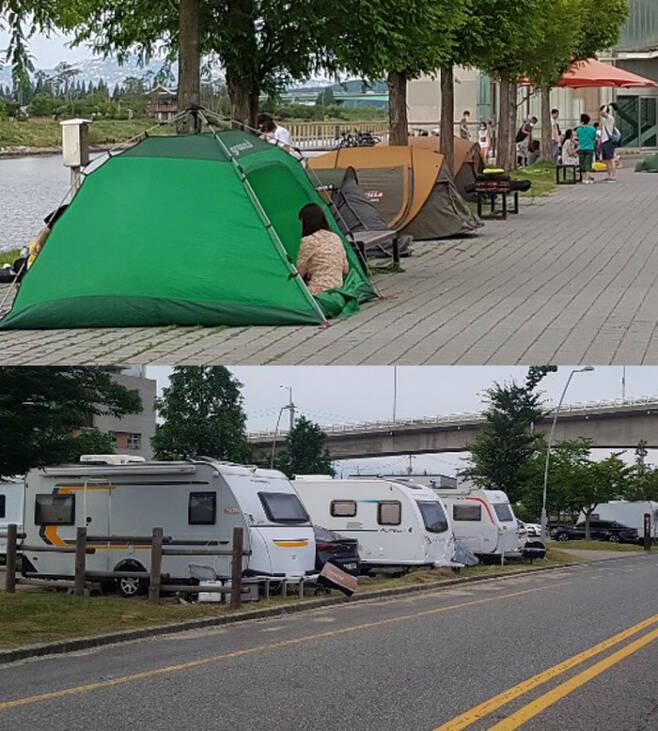 지난 12일 야영과 취사가 금지된 경인아라뱃길 수변에 시민들이 텐트를 치고 휴일을 즐기고 있다(위 사진). 도로 옆엔 캠핑카들이 주차돼 있다. 이 역시 불법이다.