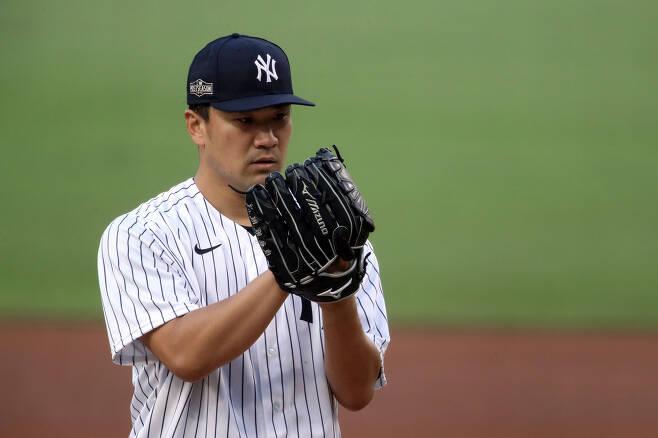 뉴욕 양키스가 다나카 마사히로가 팀과 재계약할 수 있을까. 지난 8일(한국시각) 탬파베이 레이스와의 디비전시리즈 3차전에 선발등판한 다나카. AFP연합뉴스