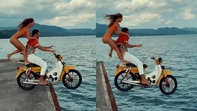 러시아인 세르게이 코센코씨가 발리 한 항구에서 여성을 오토바이에 태운 채 바다로 뛰어들고 있다. 인스타그램 캡처